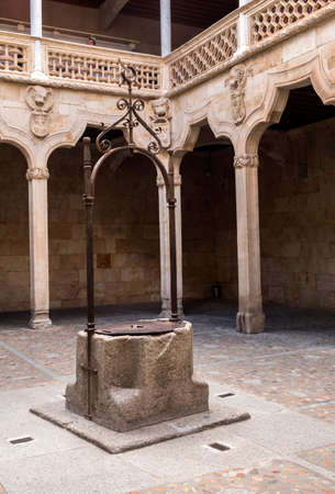 Salamanca, Spain -  August 18, 2019: Courtyard of public library situated in the house of shells at Salamanca, Spain.
