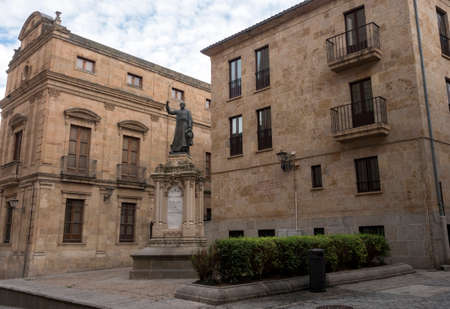 Salamanca, España - August 18, 2019: statue of Father Camara, Tomás de Cámara y Castro, located in front of the main facade of the New Cathedral, next to the Episcopal Palace, in John XXIII Square, Salamanca, Spain
