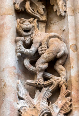 Salamanca, España - August 18, 2019: Detail of dragon sculpted in stone in the porch of the cathedral, Salamanca, Spain Editorial