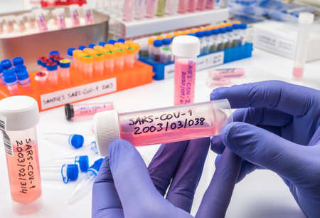 Vials with samples of SARS-COV-1 prepared cold in a laboratory, epiedomological study on Sars-CoV-2 Covid-19, conceptual image