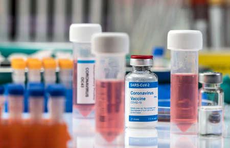 Coronavirus covid-19 experimental vaccine in a laboratory, conceptual image