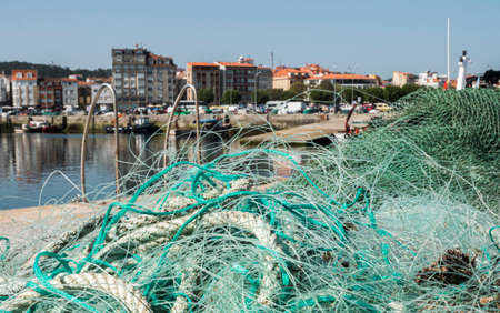 Fishing nets, panoramic view of the fishing port of o Grove, province of Pontevedra, Spain