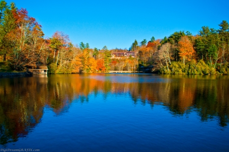 blue lake and autumn reflections Stock Photo