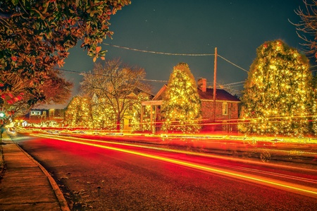 Traffic lights and light trails during busy christmas holiday season at mcadenville north carolina photo