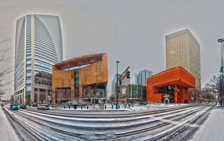 Charlotte skyline in snow and mint museum on left