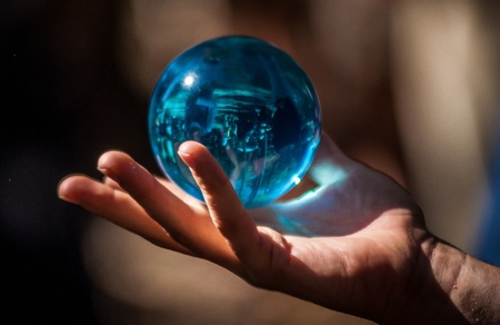 magical equipment: crystal ball in hand