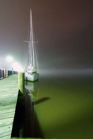 sail boat parked at the pier photo