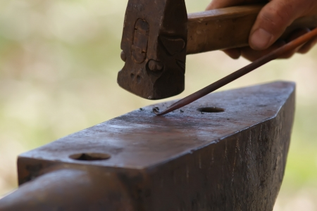 smithy: Making a decorative element in the smithy on the anvil
