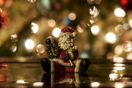 Festive santa with Christmas light background photo