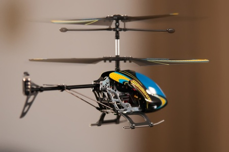 Flying RC helicopter indoors Stock Photo