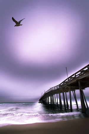 Moody picture of the outer banks Beach fishing pier at dawn photo