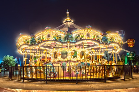 fairground: View of a carousel at night,