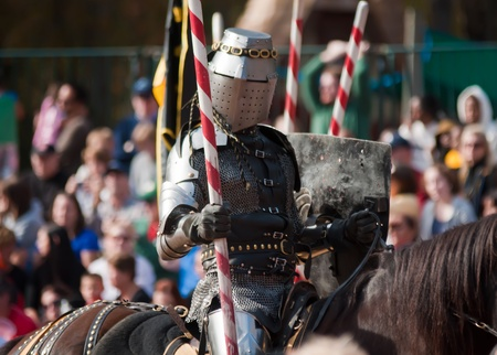 joust: Armored rider with lance on horse