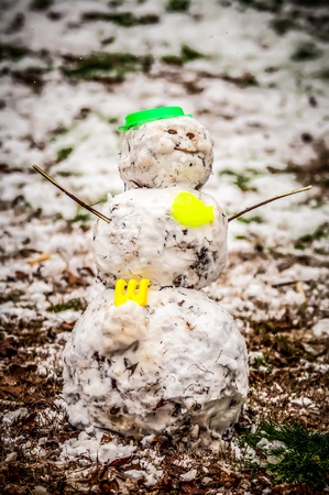 Dirty snowman made of snow and leaves in the backyard Stock Photo - 18091433