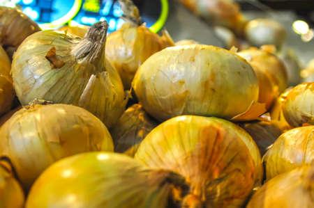 onion heap on open market as background Stock Photo - 18650673