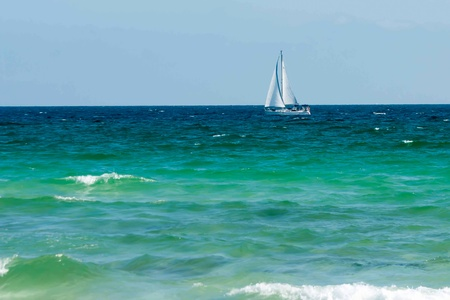 sail boat on ocean photo