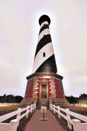 lighthouse keeper: Bodie Island Lighthouse and keepers quarters in Cape Hatteras National Seashore, south of Nags Head, North Carolina, USA
