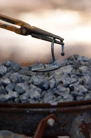 iron smith working near hot coal