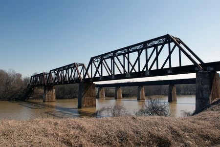 railroad bridge over river photo
