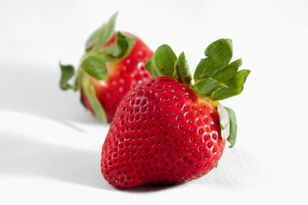 Two strawberries isolated on white background photo