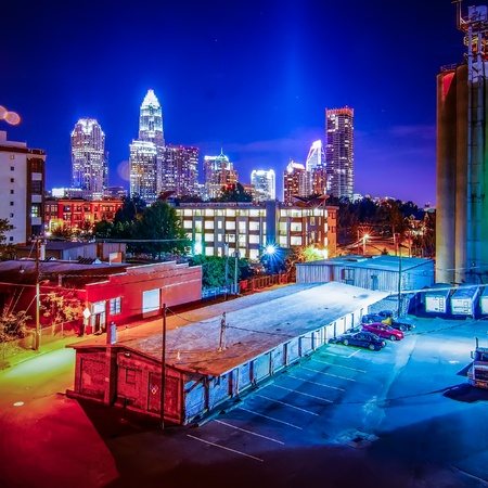 Charlotte City Skyline and architecture at night and milling factory photo