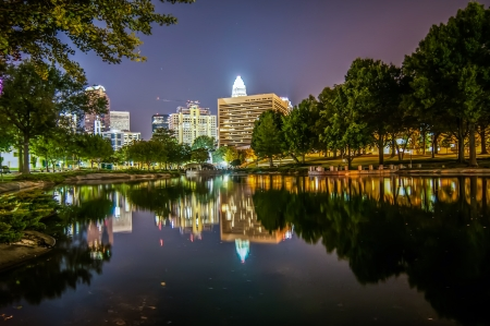 Charlotte City Skyline and architecture at night with reflections Stock Photo