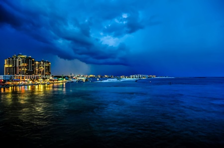 destin: stormy thunder and lightning clouds over destin florida Stock Photo