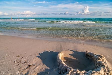 sand structures on beach near ocean waves Stock Photo