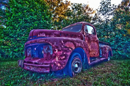 abandoned rusty vehicle on the farm lawn photo