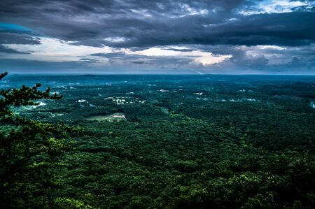 crowders mountain views with clouds and fog at sunset photo