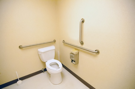ada clean public toilet with grab bars for handicapped photo