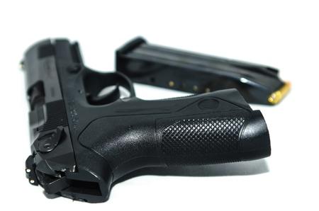 millimeter: 9mm nine millimeter handgun pistol and ammunition in magazine Stock Photo