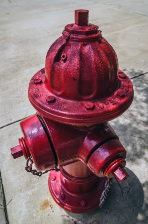 red fire hydrant on city street sdewalk photo