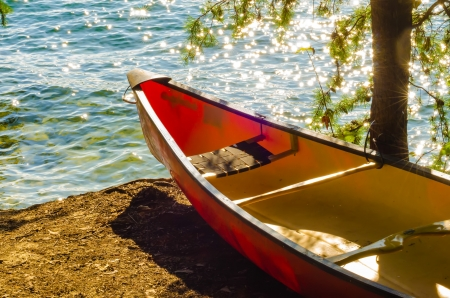 kayaks standing by the lake water photo