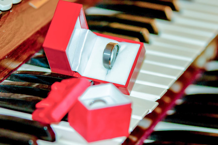 two wedding bands on piano keys photo