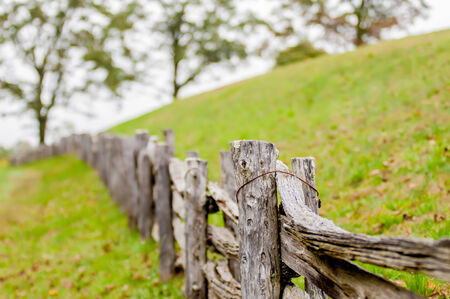 Rustic home made split rail fence in the mountains of North Carolina and virginia photo