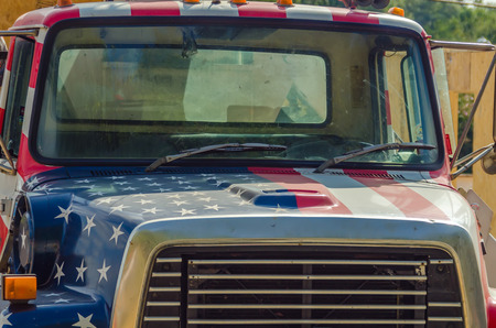 a construction vehicle wrapped in usa flag Editorial