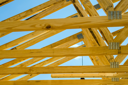 housebuilding: new structure roof construction on sunny day