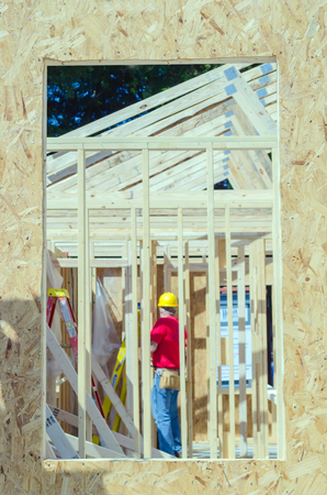 wood frame construction job seen trhough window opening Stock Photo - 22907829