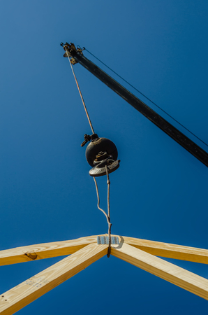 construction crane at a job site lifting heavy objects photo