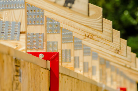 housebuilding: wooden structure of a new home roof