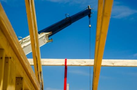 housebuilding: crane at work on construction site