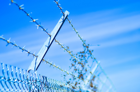 barb wire fence securing a perimeter photo