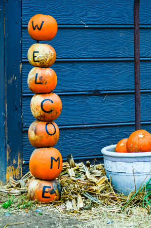 pumpkins welcome sign decorations during holidays at farm photo