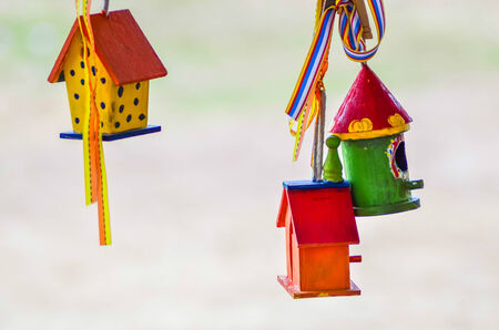 little colorful bird houses on clothes line photo