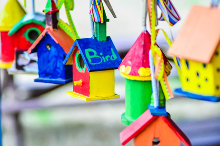 little colorful bird houses on clothes line