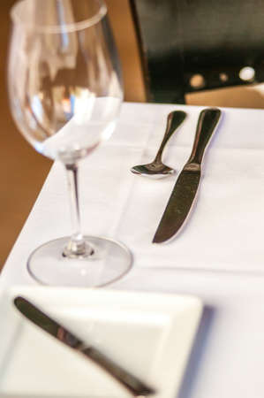 stereotypically: elegant dinner table set with knife fork and wine glass