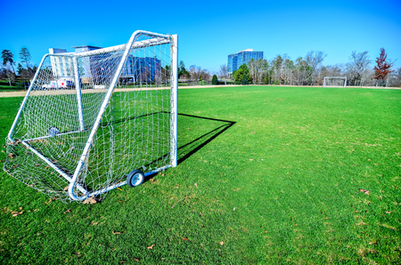 goalpost: soccer field on a sunny day in a Public Park Editorial