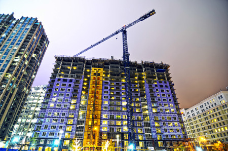 light duty: tall highrise building under construction in a big city