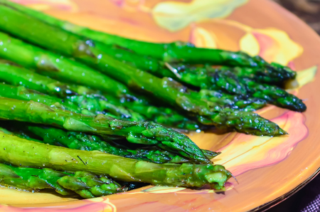 Sauteed Organic Asparagus with Herbs and Garlic on plate